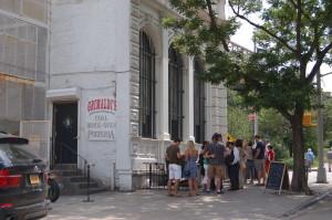 standing in line at Grimaldi's pizza in under the Brooklyn Bridge